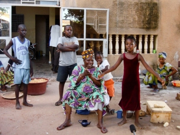 Mali. Singer Bako Dagnon with her two granddaughters
