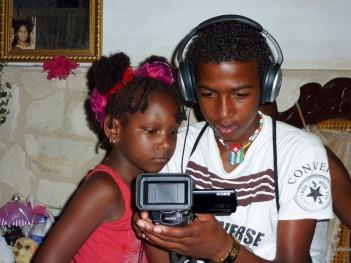 Cuba. Yuniscleivys and Wendy (Ramos family) watching Geoff's film footage
