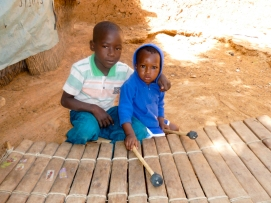 Mali. 7-year-old Daniel Dembele with his 1-year-old cousin Batoma