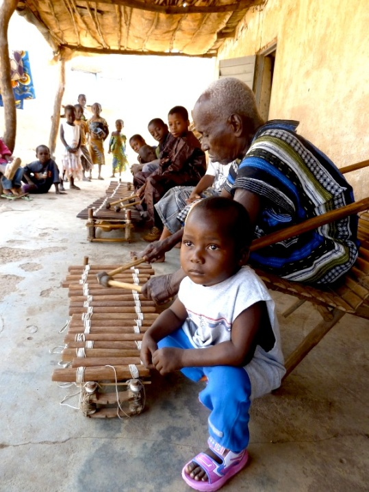 Guinea. Master balafon player from the Niagassola village with his sons and grandsons
