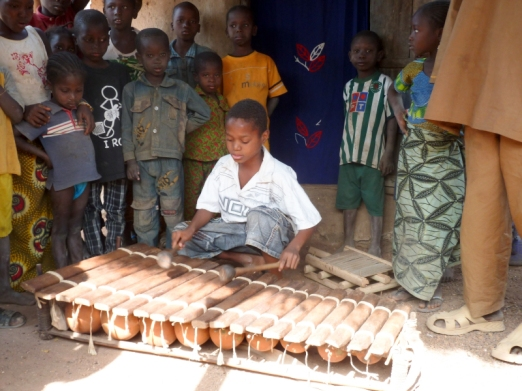 Guinea. Nansiramady Kouyaté playing the balafon in Niagassola
