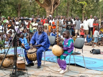 Daniel Dambele performing with his older brother Baba Dambele