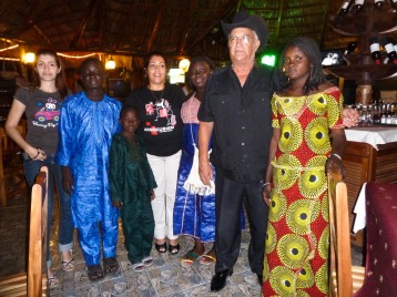 The four Malian children with Cuban music legend Eliades Ochoa and his family